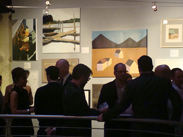 Attendees mingle and view the artwork coming up for auction.