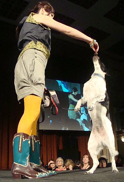 Johnna Wells and her dog Oliver on the runway