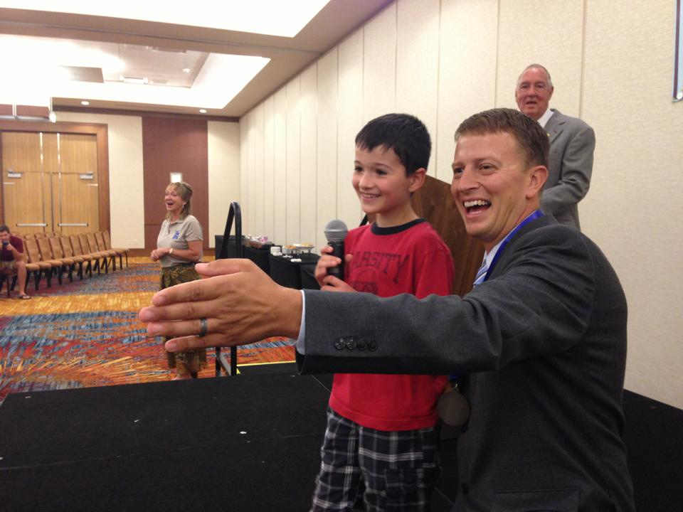 The 2013 IAC Men's Division Champion, Andy White, with my little pal, Jacob Massart during the Children's Fun Auction!